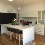 Black-pantries-and-white-cupboards-with-stone-benchtop